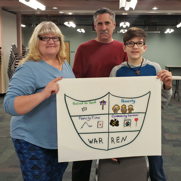 Family displaying their family shield