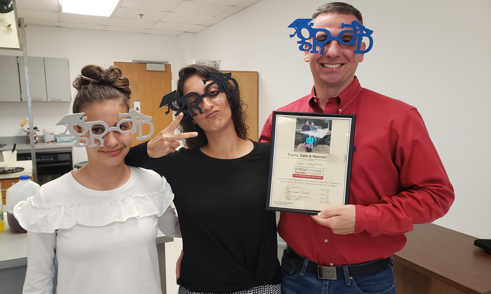 Graduating family posing with funky glasses