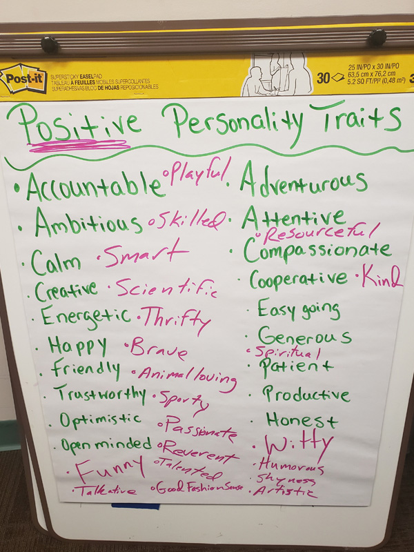 Youth session flip chart displaying positive personality traits.