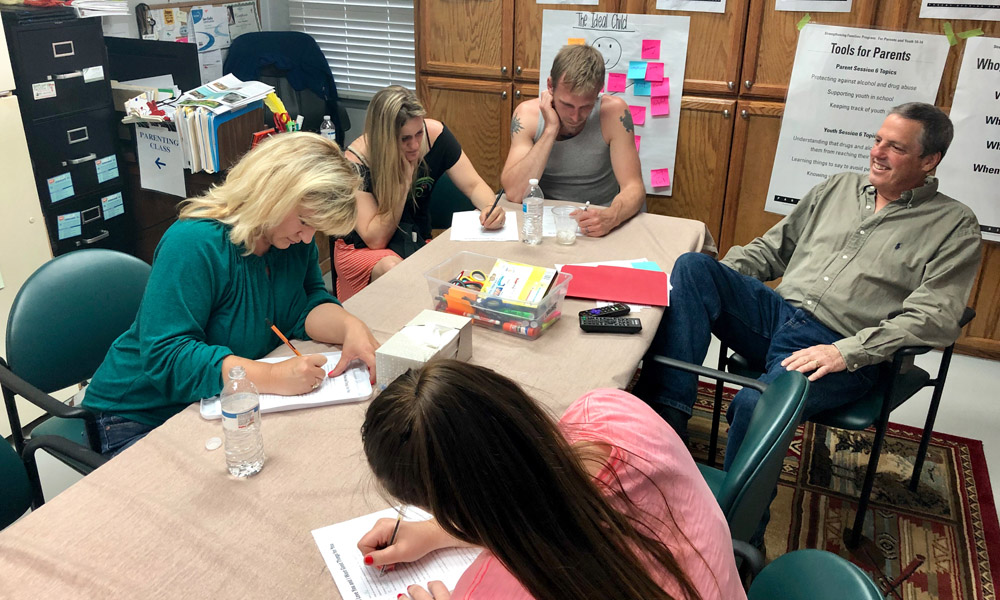 """Parent participants completing the """"I Love You and I Want Good Things for You"""" worksheet"""