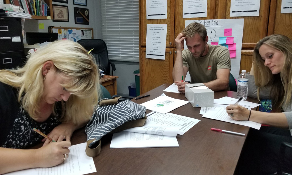 Parents completing the letters to their children