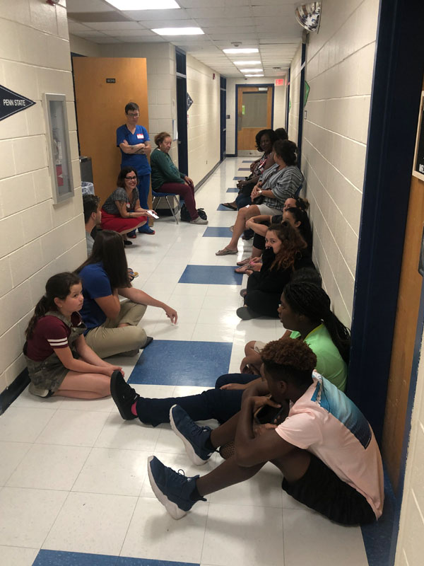 Taking shelter from tornado in hallway