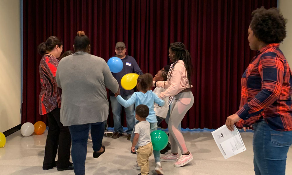 families playing the balloon game