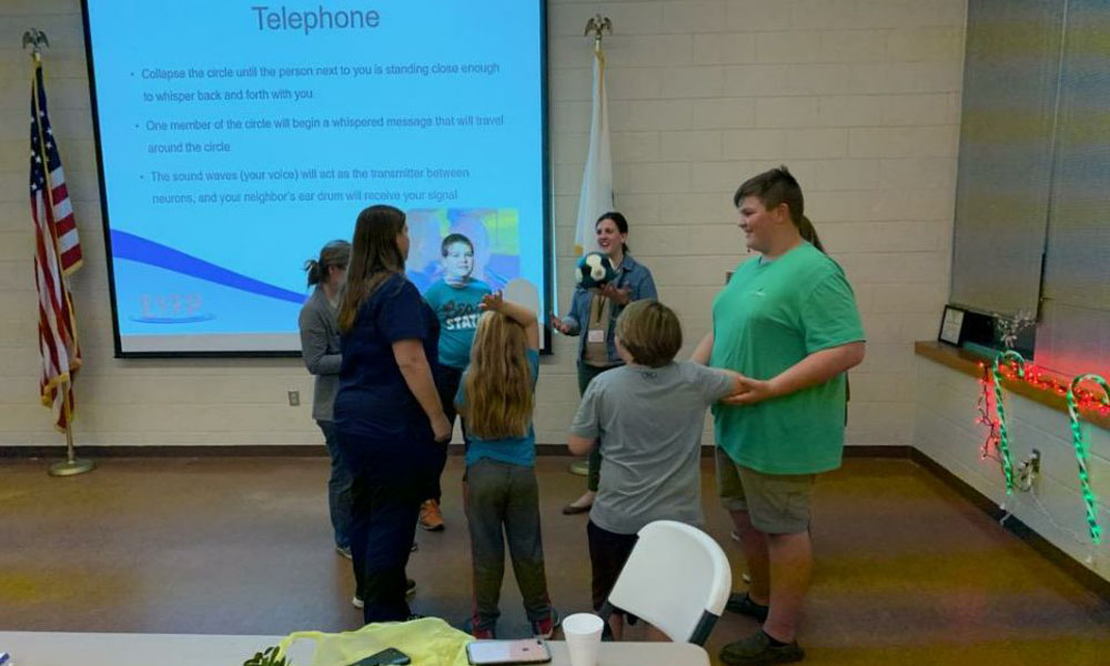 Family session game of telephone to learn about neurons and how opioids can disrupt the transmission between neurons.