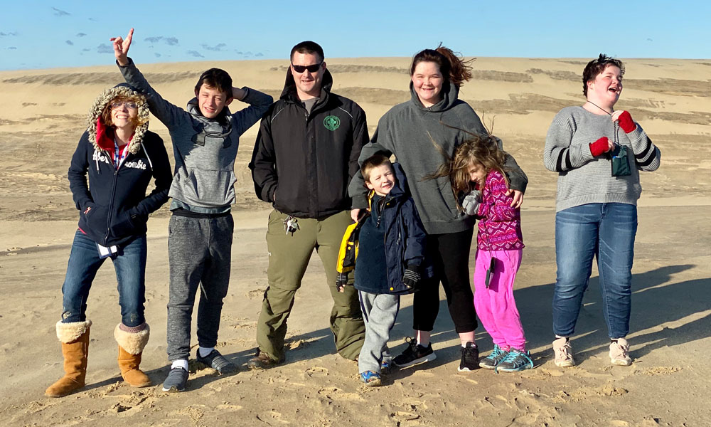 Our family on the dunes at Jockey's Ridge State Park in Nags Head, NC