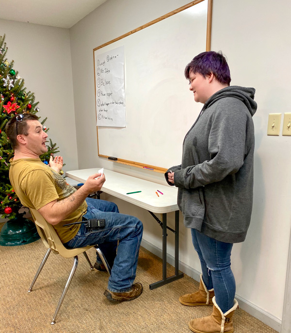 Caregiver and youth role playing a scenario with roles reversed.