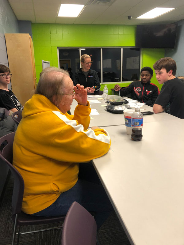 Adult talks to youth about who their role models are.