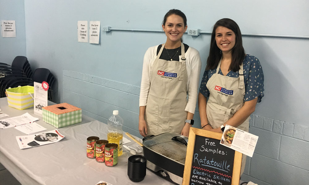 interns helping with a food demonstration