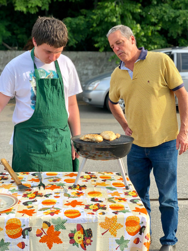Peirce overseeing one of the 4-H Outdoor Cookery club's practice cooks