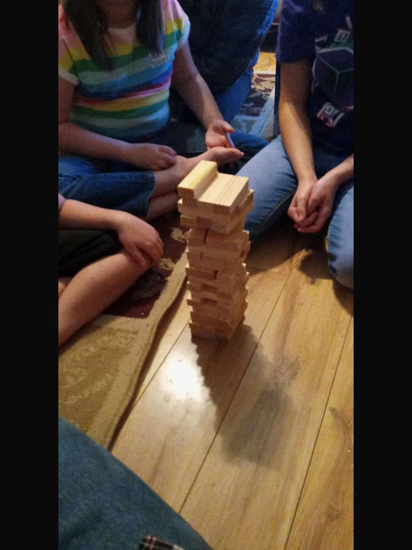 "The family playing ""Jenga"""