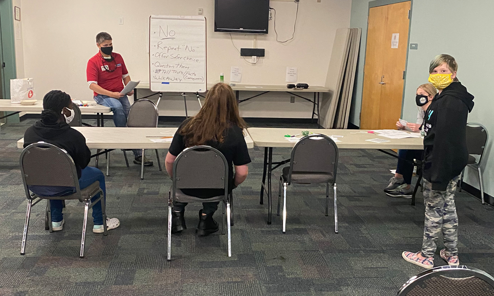 John facilitates what tools and skills youth can use when they are tempted to do engage in risky behavior by their peers.