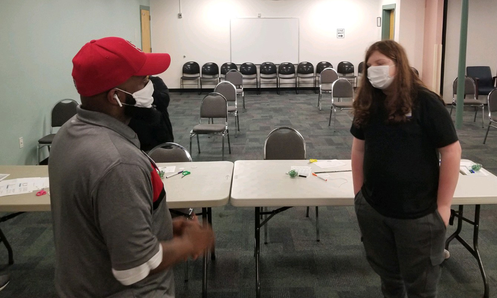 Lee does role playing with youth using the safe choices tools.