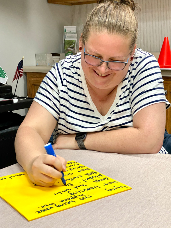Caregiver creating a list of unacceptable behaviors for her youth
