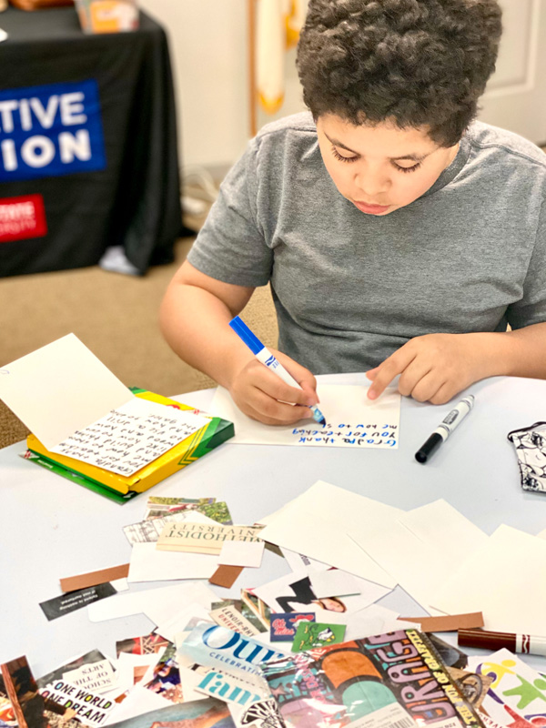 Youth participant writing thank you cards to a trusted adult in his life.