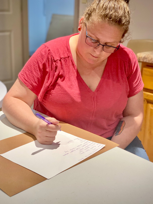 Caregiver creating a list of community agencies in Yancey County