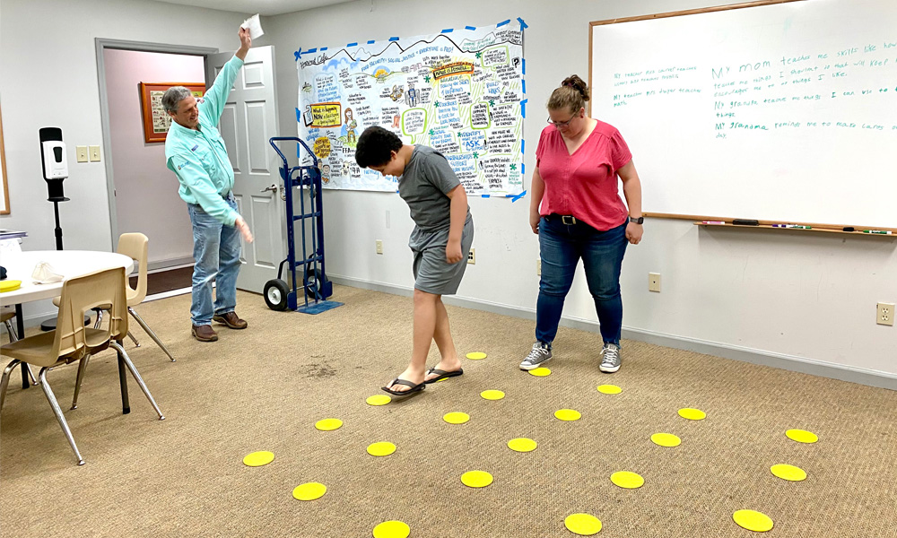 """Youth and caregiver participants playing our version of the """"mine field"""" game"""